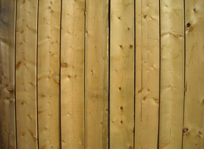 this image shows wood fence in Fullerton, California